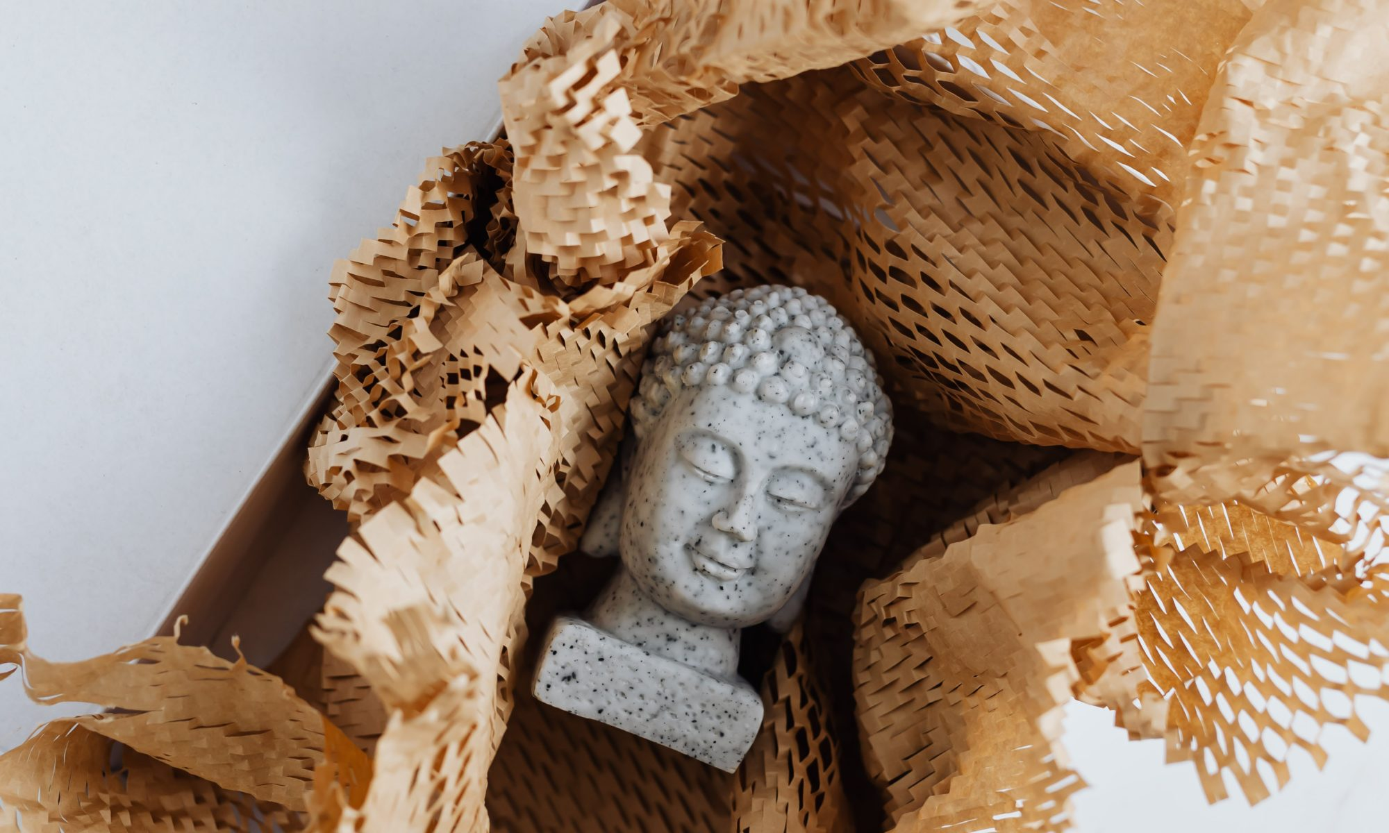 Buddha head in packing material