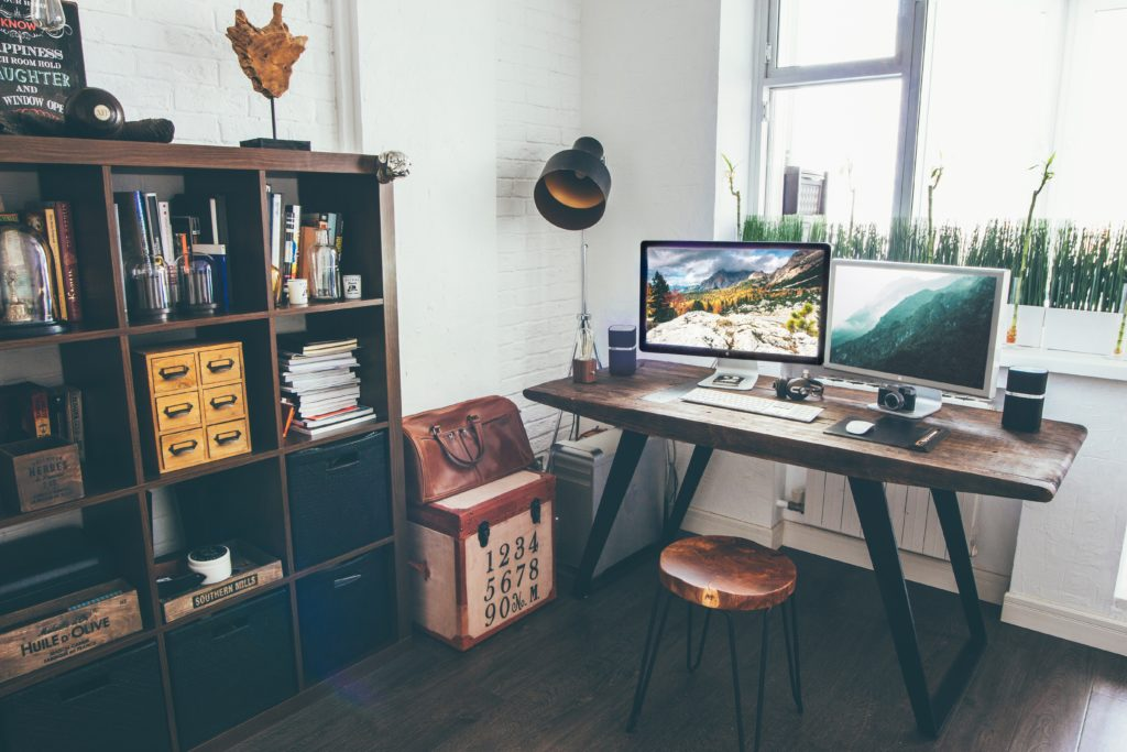 Neat desk looking out a window, with monitors and shelves (image: Vadim Sherbakov)